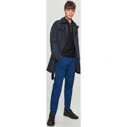 Jeansy tapered fit - Niebieski. Niebieskie jeansy męskie relaxed fit marki QUECHUA, m, z elastanu. Za 149,99 zł.