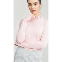 Jasnoróżowy Sweter Remember. Czerwone swetry klasyczne damskie other, na jesień, m. Za 59,99 zł.