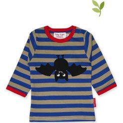 Koszulka w kolorze niebiesko-beżowym. Niebieskie bluzki dziewczęce bawełniane Toby Tiger, w paski, z okrągłym kołnierzem, z długim rękawem. W wyprzedaży za 85,95 zł.