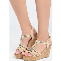 Beżowe Sandały Maturity. Brązowe sandały damskie marki Reserved, na platformie. Za 99,99 zł.