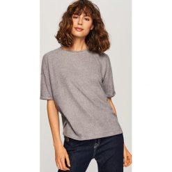 Koszulka oversize - Jasny szar. Białe t-shirty damskie marki KALENJI, z materiału, z dekoltem na plecach. Za 49,99 zł.