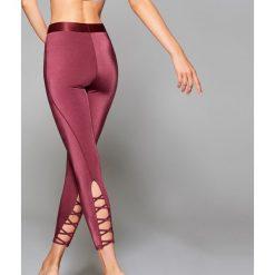 Sportowe legginsy Athleisure - Bordowy. Czerwone legginsy sportowe damskie marki Mohito, z bawełny. Za 89,99 zł.