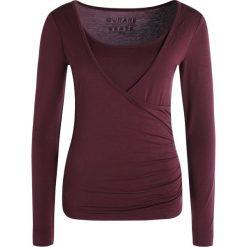 Curare Yogawear Bluzka z długim rękawem kastanie. Brązowe bluzki damskie Curare Yogawear, l, z elastanu, z długim rękawem. W wyprzedaży za 129,35 zł.