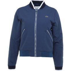 Lacoste Sport BOMBER JACKET Kurtka Outdoor inkwell/white/navy blue. Niebieskie kurtki damskie softshell Lacoste Sport, z materiału, outdoorowe. Za 1049,00 zł.