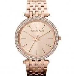 """Zegarek kwarcowy """"Darci"""" w kolorze różowozłotym. Żółte, analogowe zegarki damskie marki Michael Kors, ze stali. W wyprzedaży za 627,95 zł."""