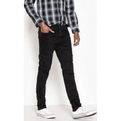 Jeansy motocyklowe krój slim. Czarne jeansy męskie slim marki La Redoute Collections, l, z bawełny, bez rękawów, krótkie, z kapturem. Za 176,36 zł.