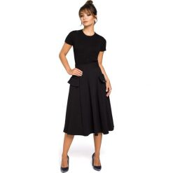 CAMILLE Rozkloszowana spódnica z kieszeniami - czarna. Czarne spódnice wieczorowe marki BE, l, z dzianiny, midi, oversize. Za 119,00 zł.