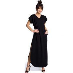 Czarna Wyjściowa Długa Sukienka z Rozcięciami na Bokach. Czarne długie sukienki marki Molly.pl, na imprezę, l, z dzianiny, wizytowe, dekolt w kształcie v, z długim rękawem, oversize. Za 158,90 zł.