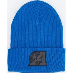 Czapka z gumową aplikacją - Niebieski. Niebieskie czapki męskie Reserved, z aplikacjami, z gumy. Za 39,99 zł.