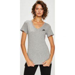 Nike Sportswear - Top. Różowe topy damskie marki Nike Sportswear, l, z nylonu, z okrągłym kołnierzem. Za 79,90 zł.