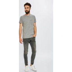 Wrangler - Jeansy Strangler. Niebieskie jeansy męskie skinny marki House, z jeansu. Za 349,90 zł.