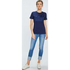 Calvin Klein Jeans - Top. Szare topy damskie marki Calvin Klein Jeans, l, z nadrukiem, z bawełny, z okrągłym kołnierzem. W wyprzedaży za 159,90 zł.