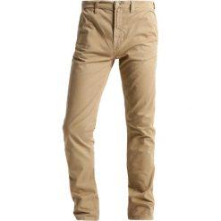 Nudie Jeans ADAM Chinosy beige. Czarne jeansy męskie marki Criminal Damage. Za 579,00 zł.