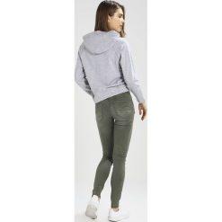 GStar DSTAQ 5PKT MID SKINNY COJ Jeans Skinny Fit lt hunter. Zielone jeansy damskie marki G-Star. W wyprzedaży za 391,30 zł.