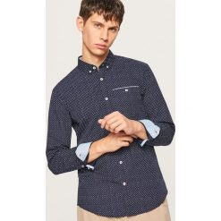 Koszula slim fit w drobny wzór - Granatowy. Niebieskie koszule męskie slim marki QUECHUA, m, z elastanu. Za 89,99 zł.