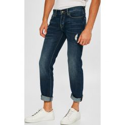 Guess Jeans - Jeansy Sonny. Szare jeansy męskie slim marki Guess Jeans, l, z aplikacjami, z bawełny. W wyprzedaży za 339,90 zł.