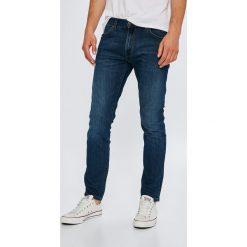 Wrangler - Jeansy Larston Dark Vantage. Niebieskie jeansy męskie slim marki House, z jeansu. W wyprzedaży za 279,90 zł.