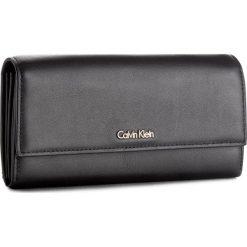 Duży Portfel Damski CALVIN KLEIN - Compact Large Trifol K60K604009 001. Czarne portfele damskie marki Calvin Klein, ze skóry. W wyprzedaży za 349,00 zł.