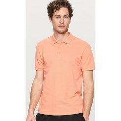 Klasyczna koszulka polo - Pomarańczo. Różowe koszulki polo Reserved, m. Za 39,99 zł.