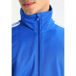 Adidas Originals TRAINING Bluza rozpinana blue. Szare bluzy męskie rozpinane marki adidas Originals, na co dzień, z nadrukiem, z bawełny, casualowe, z okrągłym kołnierzem, proste. Za 359,00 zł.