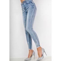 Rurki damskie: Rozjaśniane jeansy high waist z przetarciami
