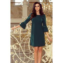 Haven sukienka z koronką na rękawkach - ZIELEŃ BUTELKOWA. Zielone sukienki hiszpanki numoco, s, w koronkowe wzory, z koronki, rozkloszowane. Za 139,99 zł.