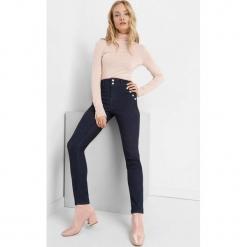 Jegginsy z wysokim stanem. Brązowe legginsy marki Orsay, s, z dzianiny. Za 99,99 zł.