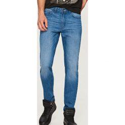 Jeansy regular fit - Niebieski. Niebieskie jeansy męskie regular Reserved. Za 99,99 zł.