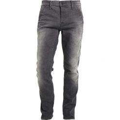 GStar BRONSON SLIM JEANS Jeansy Slim Fit light aged destroy. Białe jeansy męskie marki G-Star, z nadrukiem. W wyprzedaży za 454,30 zł.