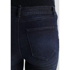 Vila VIJUNAS Jeansy Slim Fit dark blue denim. Niebieskie jeansy damskie relaxed fit marki Vila. W wyprzedaży za 186,75 zł.