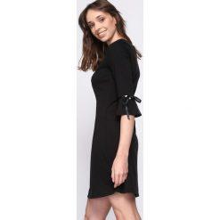 Czarna Sukienka Careless Whisper. Czarne sukienki Born2be, l, mini. Za 69,99 zł.