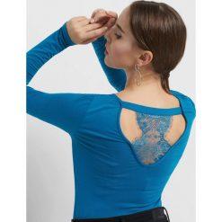 Koszulka z koronką. Czarne t-shirty damskie Orsay, xs, w koronkowe wzory, z dzianiny, z dekoltem na plecach. Za 39,99 zł.