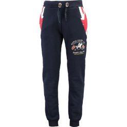 """Spodnie dresowe """"Moduk"""" w kolorze granatowym. Niebieskie spodnie dresowe męskie Geographical Norway, z aplikacjami, z dresówki. W wyprzedaży za 117,95 zł."""