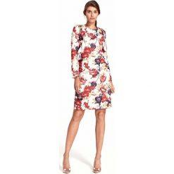 Wizytowa Sukienka w Kwiaty z Pionową Falbanką. Białe sukienki balowe Molly.pl, na spotkanie biznesowe, l, w kwiaty, z dekoltem na plecach, z długim rękawem, oversize. W wyprzedaży za 158,01 zł.
