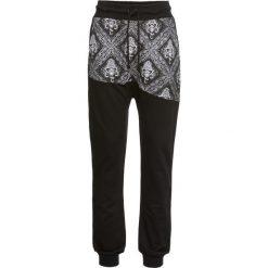 Spodnie sportowe haremki bonprix czarny. Czarne spodnie sportowe damskie marki KIPSTA, l, z bawełny, na fitness i siłownię. Za 89,99 zł.