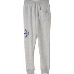 Spodnie sportowe damskie: Adidas Spodnie dresowe ORIGINALS sl72 baggy W szare r. 34 (AB2386)