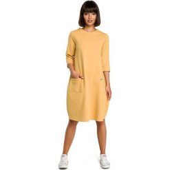 Żółta Luźna Sukienka Bombka z Ozdobnymi Przeszyciami. Żółte sukienki dzianinowe marki Molly.pl, l, sportowe, z okrągłym kołnierzem, bombki. Za 129,90 zł.