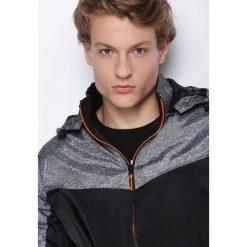 Czarna Kurtka Entirety. Czarne kurtki męskie marki Born2be, l, z aplikacjami, z dresówki. Za 119,99 zł.