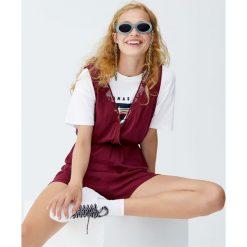 Krótki kopertowy kombinezon. Czerwone kombinezony damskie marki KALENJI, z elastanu, z krótkim rękawem, krótkie. Za 49,90 zł.