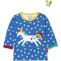 Koszulka w kolorze niebieskim. Niebieskie bluzki dziewczęce bawełniane Toby Tiger, z aplikacjami, z okrągłym kołnierzem, z długim rękawem. W wyprzedaży za 85,95 zł.