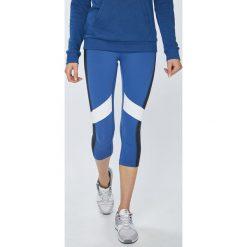 Reebok - Legginsy. Szare legginsy skórzane marki Reebok, l. W wyprzedaży za 199,90 zł.
