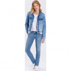 """Dżinsy """"Melissa"""" - Skinny fit - w kolorze niebieskim. Niebieskie rurki damskie marki Cross Jeans, z aplikacjami. W wyprzedaży za 136,95 zł."""