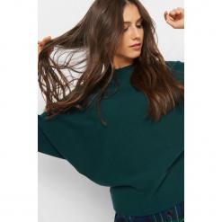 Nietoperzowy sweter. Czarne swetry klasyczne damskie marki KIPSTA, m, z elastanu, z długim rękawem, na fitness i siłownię. Za 79,99 zł.