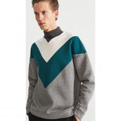 Bluza w geometryczne wzory - Turkusowy. Czerwone bluzy męskie marki KALENJI, m, z elastanu, z długim rękawem, długie. Za 119,99 zł.
