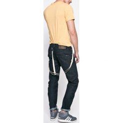 G-Star Raw - Jeansy. Niebieskie jeansy męskie slim marki G-Star RAW. W wyprzedaży za 359,90 zł.
