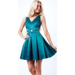 Sukienka z ozdobnymi kamykami zielona G50111. Czarne sukienki marki Fasardi, m, z dresówki. Za 159,00 zł.