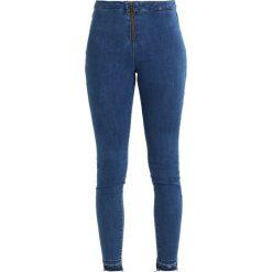 Even&Odd EXPOSED ZIPPER MID WAIST Jeans Skinny Fit blue denim. Niebieskie rurki damskie Even&Odd. Za 129,00 zł.