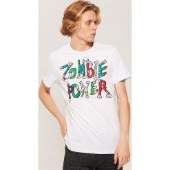 T-shirt z napisem Zombie power - Biały. Czarne t-shirty męskie marki KIPSTA, z poliesteru, do piłki nożnej. Za 39,99 zł.