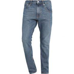 Calvin Klein Jeans 056 ATHLETIC TAPER Jeansy Zwężane blue denim. Niebieskie jeansy męskie Calvin Klein Jeans. Za 419,00 zł.