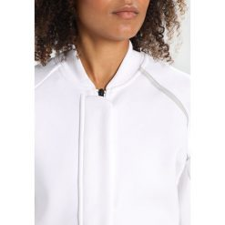 Adidas Performance TRANS Bluza rozpinana white. Czerwone bluzy rozpinane damskie marki adidas Performance, m. W wyprzedaży za 359,20 zł.